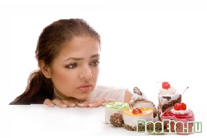 Young  attractive women wishing cookies