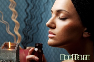 young and beautiful female face enjoying aroma therapy